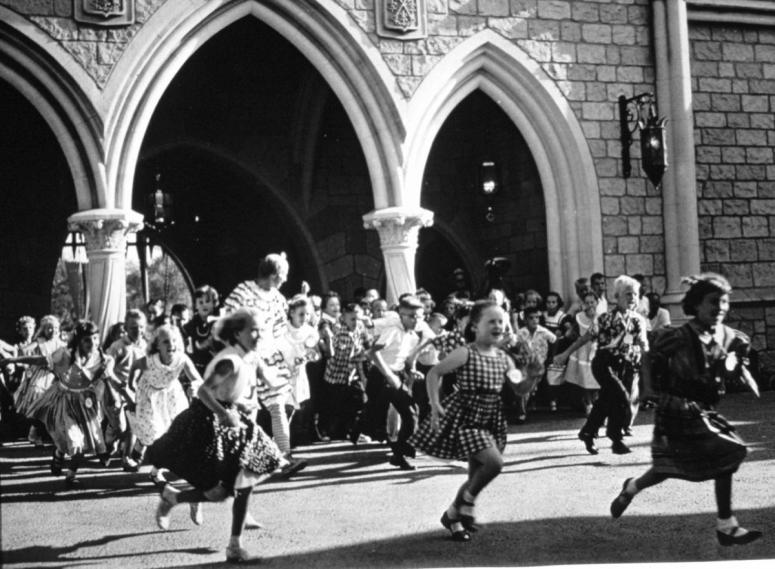 Disneyland Opening Day Children running through Sleeping Beauty Castle photo(c)Disney_0